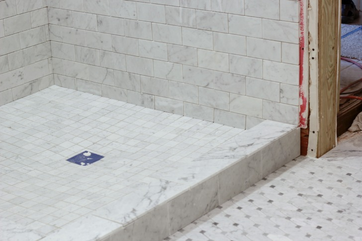 Top tiling a bathroom shower with marble tile TP37