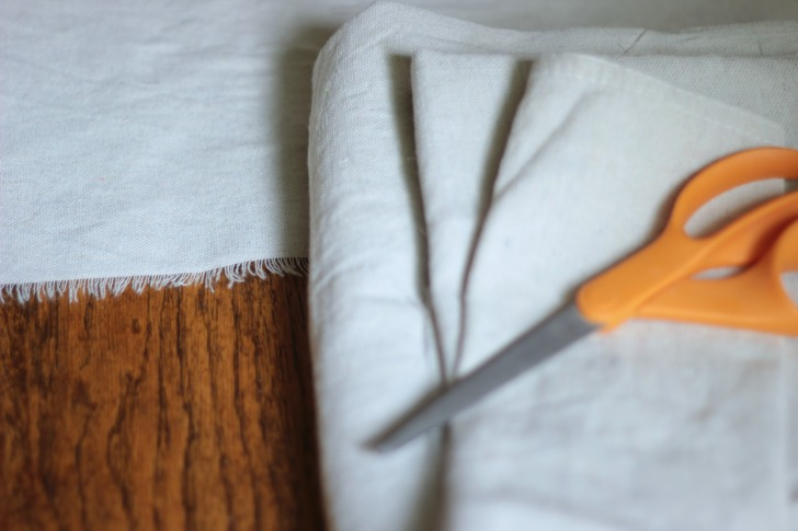 DIY grain sack table runner with a canvas drop cloth