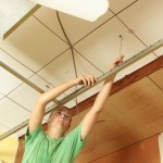 removing the drop ceiling in the guest bedroom