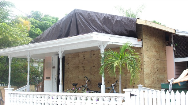 key west house exterior new roof with tarp