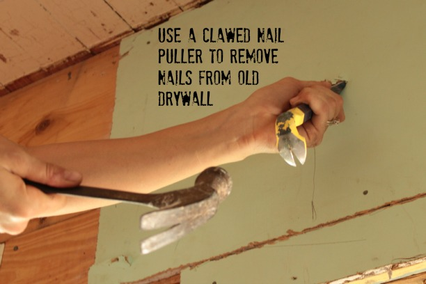use a pry bar to remove nails from old drywall