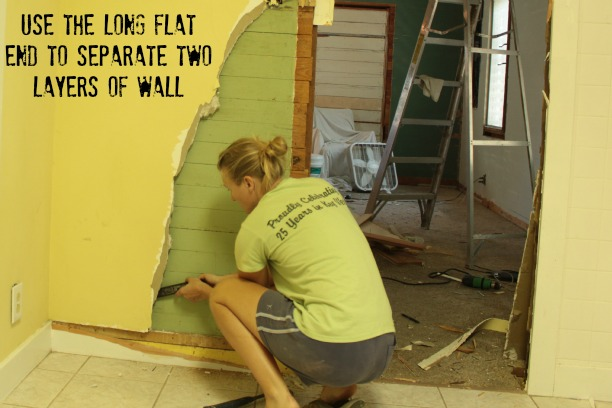 use a pry bar to remove drywall