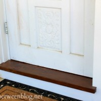 to paint or to stain the front entry threshold, the final answer
