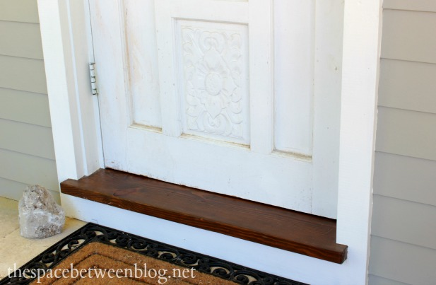 stained front entry threshold